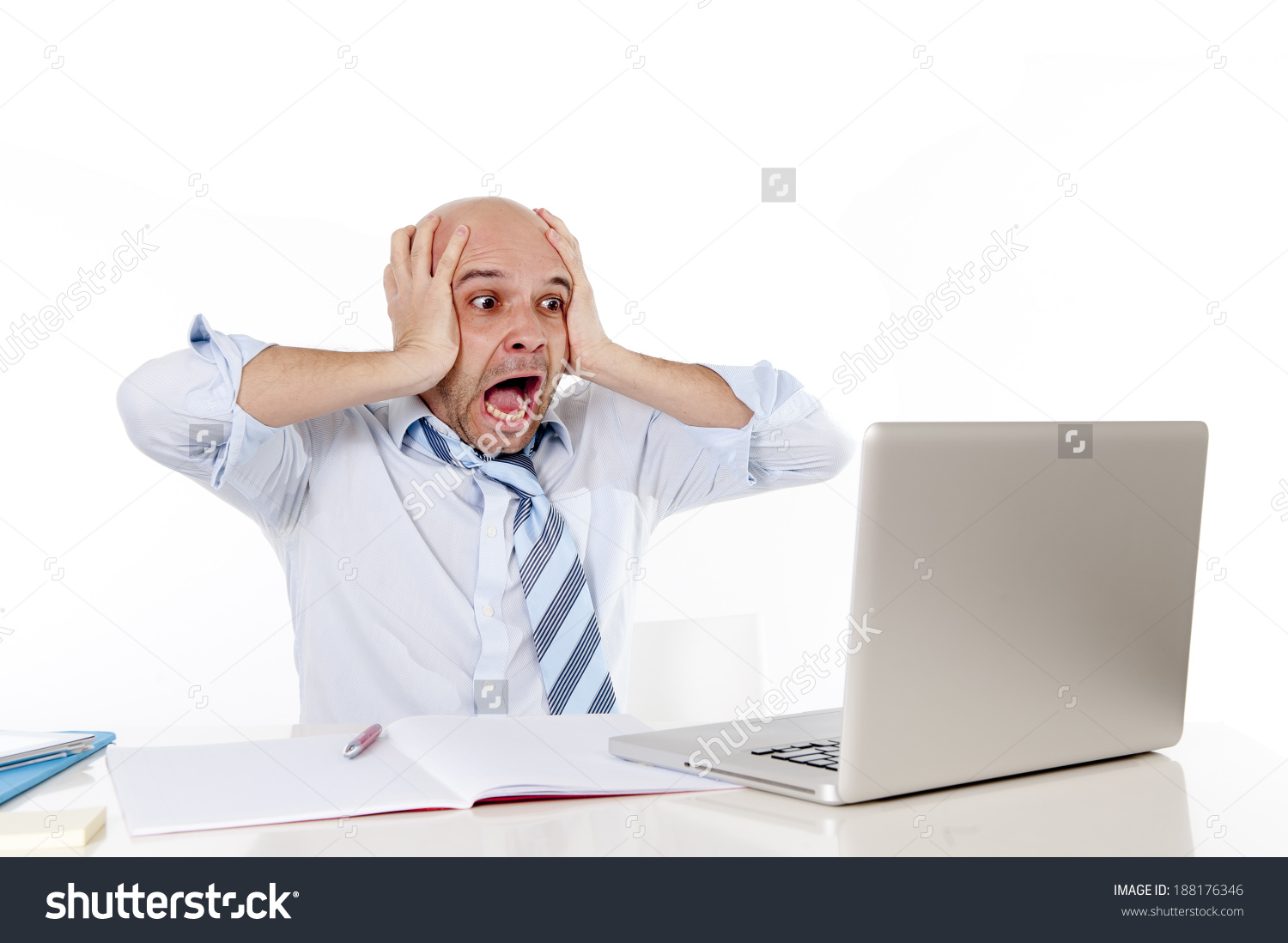 stock-photo-attractive-young-bald-business-man-screaming-in-crisis-stress-and-frustration-at-computer-from-188176346